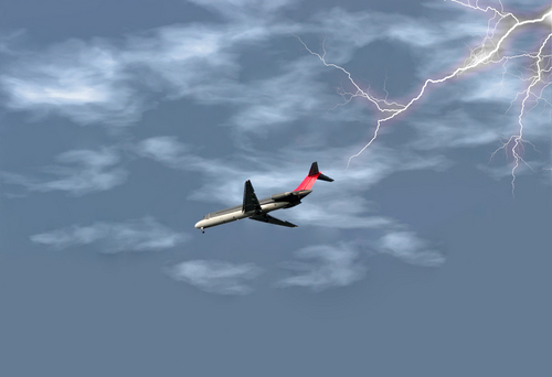 Airplane getting ready to land in the midst of a lightening storm. Shot with a Canon 20D.