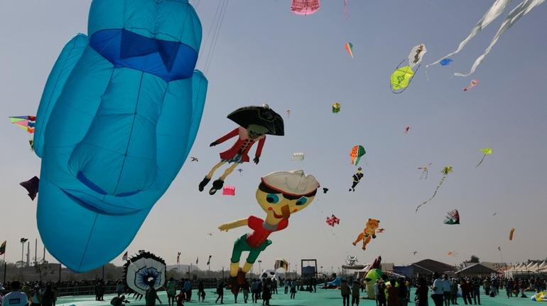 Huge kites fly during International kite festival in Ahmadabad, India, Sunday, Jan. 6, 2019. Kite flyers from various countries and across India are participating in the festival that is annually held on the Sabarmati riverfront here. (AP Photo/Ajit Solanki)