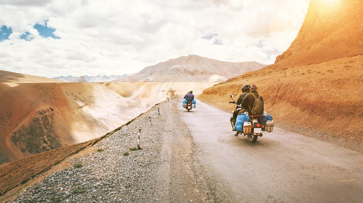 Motorcycle travelers ride in indian Himalaya roads