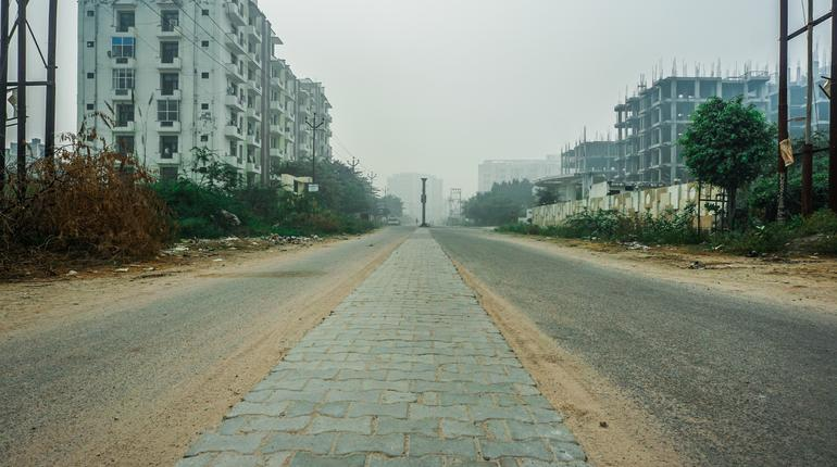 india- utter pradesh- agra- 4 november 2019, view of double sided road and building near sikandra in smokey and foggy atmosphere