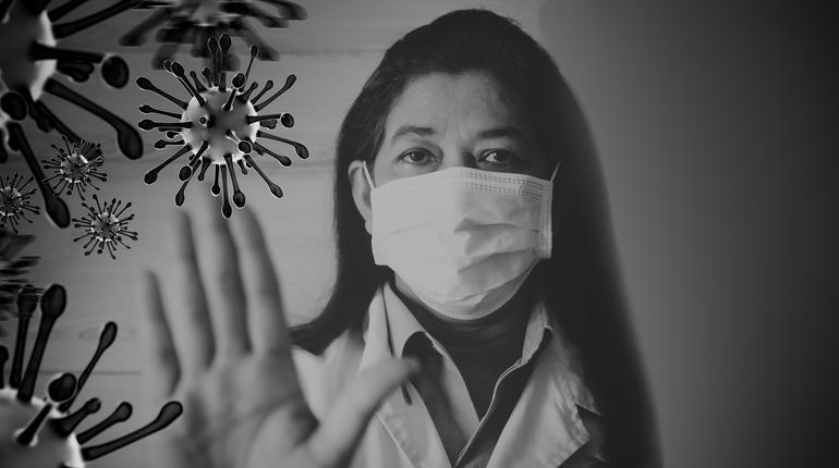 Indian Doctor wearing surgical mask for protect Coronavirus covid-19 and show stop hands gesture for stop corona virus outbreak.Scientist in biological protective Pandemic virus outbreak concept.