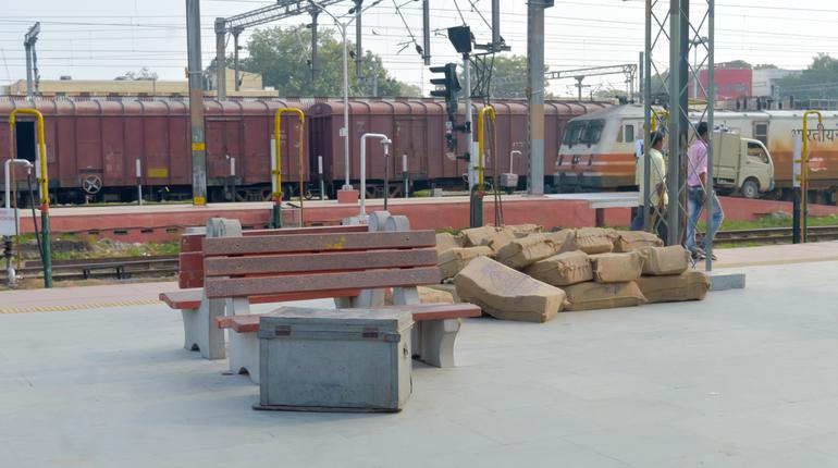 View of Box container on indian railway station platform near railway yard before loading on goods carriage on a freight train for dispatch. A trade transportation photography. Banaras, India May 2019