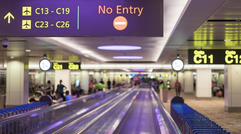 Signs in airport with blured background