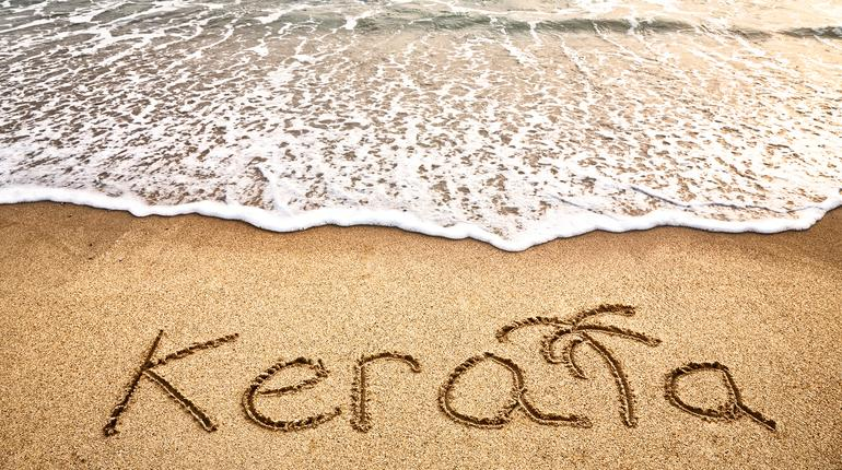 Kerala title on the sand beach near the ocean
