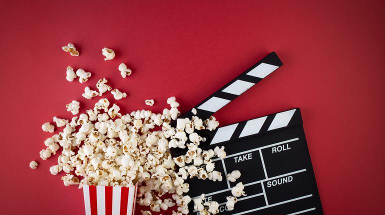 Movie clapper board and popcorn
