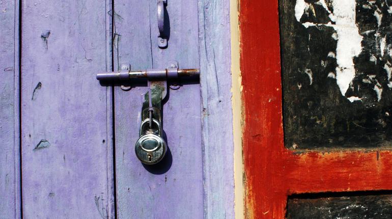 Painted Indian door with a steel lock.