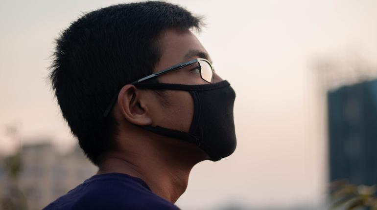 Spanish boy wears a black safety mask.Mask prevents corona virus and air pollution dust.New type coronavirus 2019-nCoV pneumonia in Wuhan has been spreading into many Countries