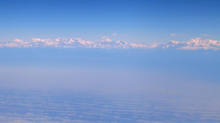 Himalaya mountains, in the clouds, view from the airplane