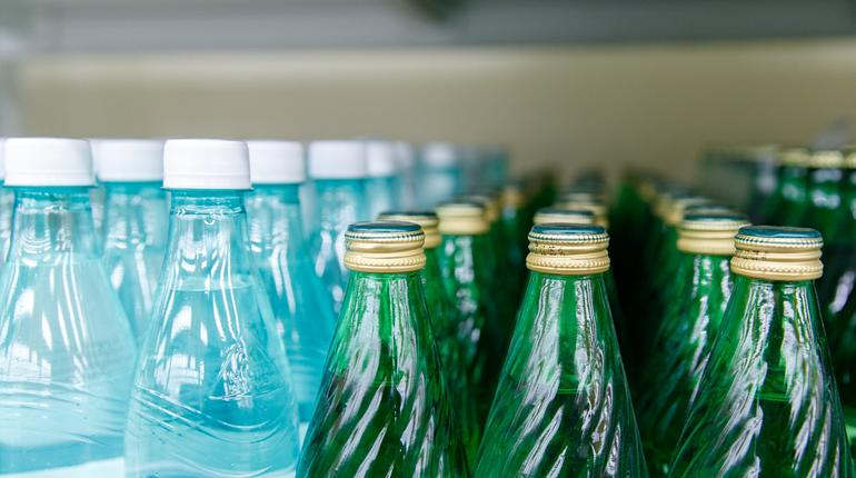 plastic and glass bottles with water, caps