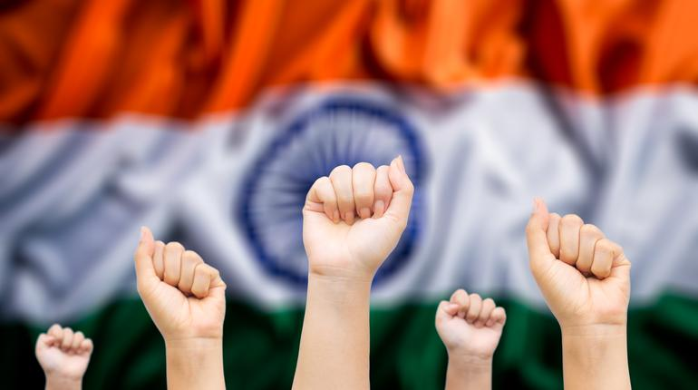 Happy India republic, Hands of people with India national flag in background. Indian Independence Day.