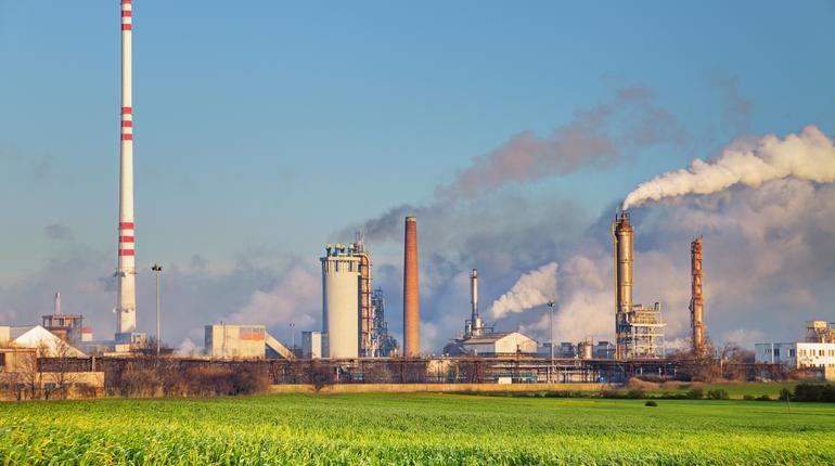 Oil refinery with vapor - petrochemical industry.