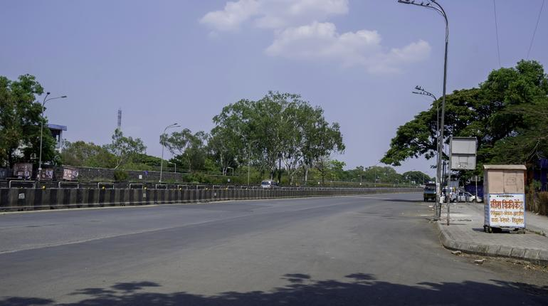 Pune, India - March 22 2020: Empty roads at Kharadi, Pune after PM Modi's call for a Public curfew from 7am to 9am on 22 March to fight and stop the spread of the Coronavirus epidemic in India.