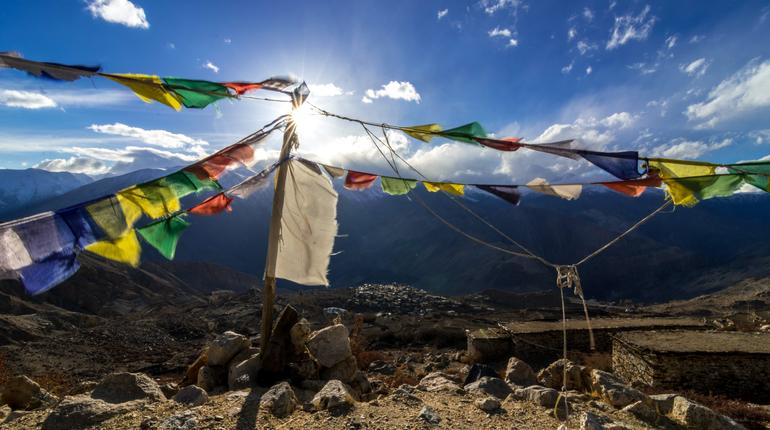 Sun Burst Over Buddhist Flag Nako Village in Kinnaur Valley - Himachal Pradesh / India