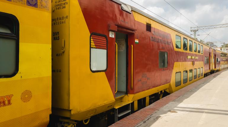 Bangalore, Karnataka, India - January 2020: The bright red and yellow bogie of the double decker express train that goes from Chennai to Bangalore.