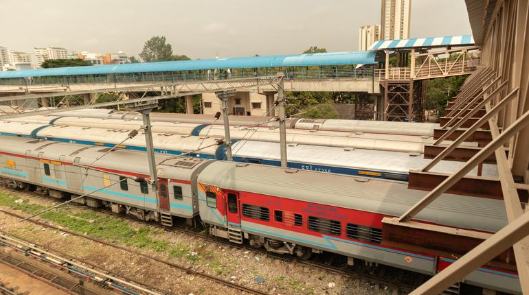 Aerial view of stack of trains standing at railway track at railway station Bengaluru.