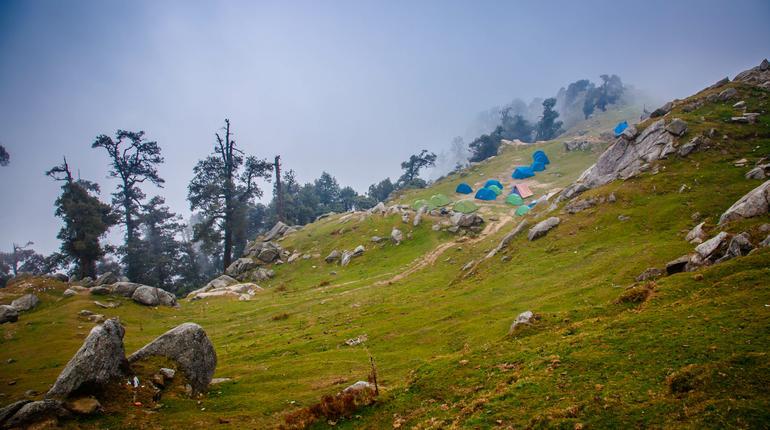 Indian magic Himalayas mountains in Dharamshala Treck to Triud. Himachal Pradesh. tent camp