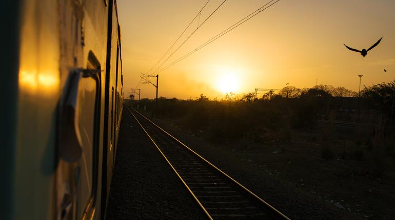 Train trip in India. Sunset view from the train to Delhi