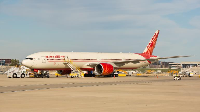 Chicago, USA - October 14, 2019: A Boeing 777-300 aircraft of Air India Airlines being serviced at O'Hare International Airport.