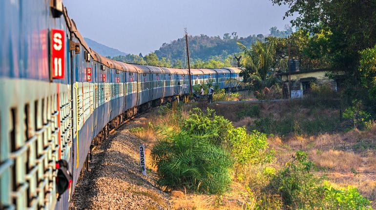 India, Maharashtra, Perspective view and curve of Indian train at the dawn. Indian trains are the cheapest way to travel around India