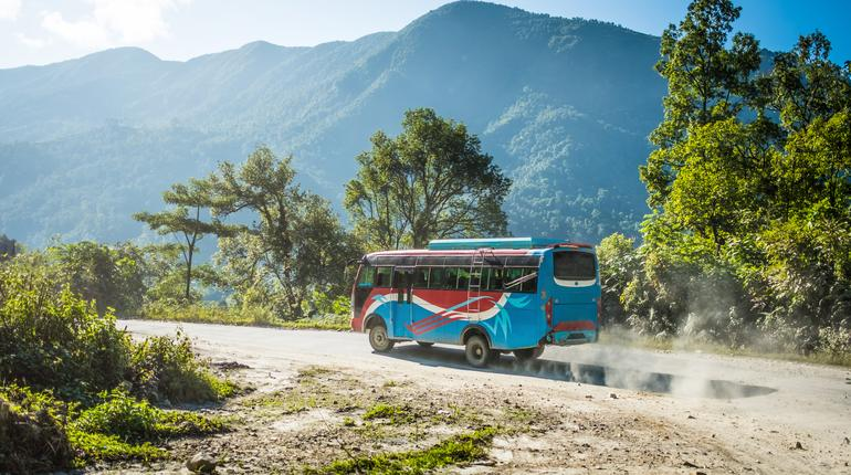 Colourful local bus on mountain road, Annapurna area, Nepal