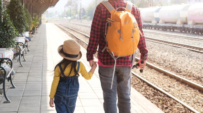 Family, father and daughter, travel backpack
