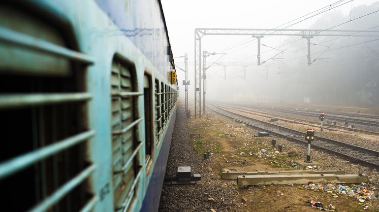 View through the window train in the polluted city of New Delhi, India. Indian Railways, often described as the Òtransport lifeline of the nationÓ, is the fourth largest railway network in the world.