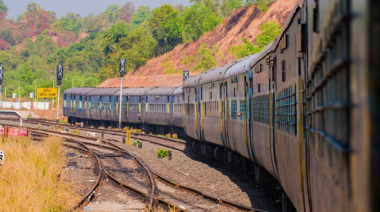A traditional train carriage in India in transit