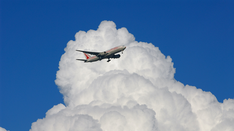 Lone Air India jet airplane amongst cumulonimbus clouds