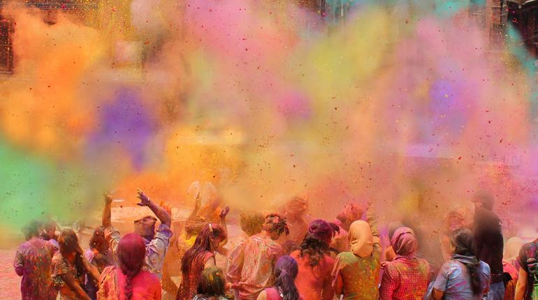 People celebrating Holi festival of colors, India