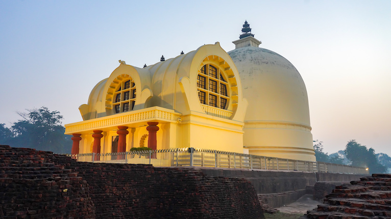 Parinirvana Stupa in Kushinagar lit up with spotlights near sunset