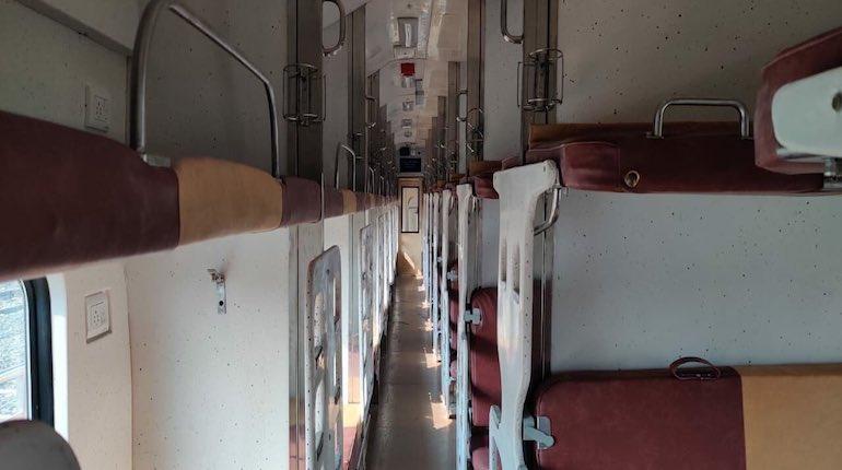 Interiors of Tejas sleeper coaches in natural light for Agartala Rajdhani Express