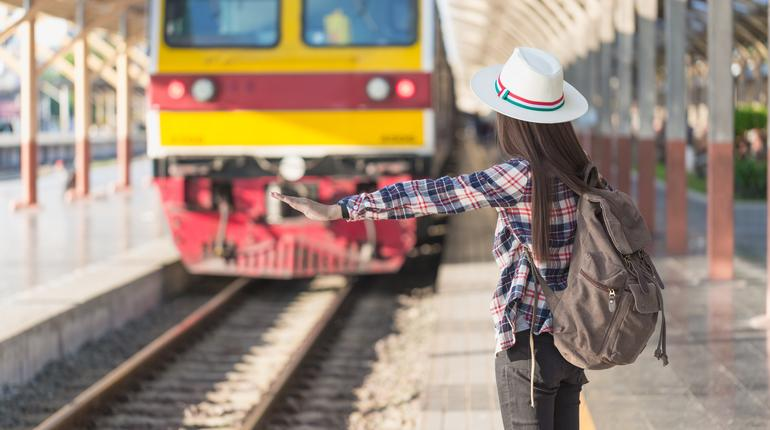 Beautiful young asian woman waiting for train at train station, Travel and vacation concept.  Chinese tourists.
