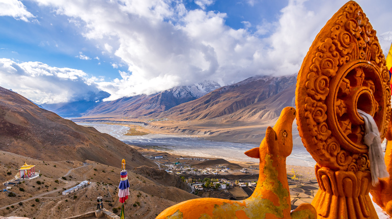 Landscape of braided Spiti river valley and snow capped mountains during sunrise from Key or Kee monastery near Kaza town in Lahaul and Spiti district of Himachal Pradesh, India.