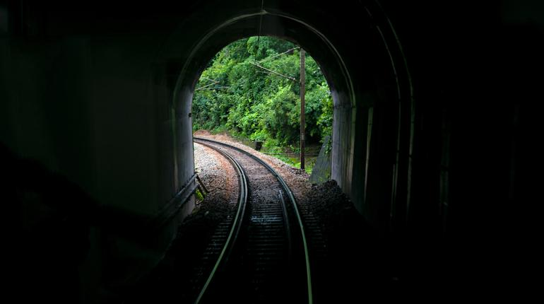 Image taken from vista-dome tourist coach of a tunnel portal with railway line.