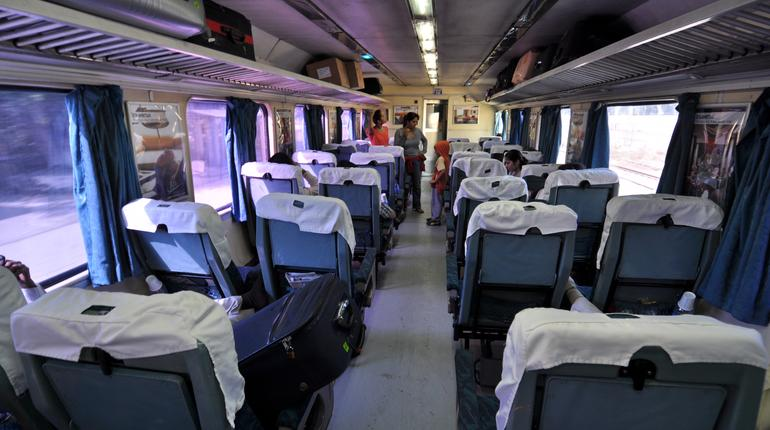 NEW DELHI, INDIA - 25 OCTOBER 2009: Interior of first class in Shatabdi Express Train on its way from New Delhi to Amritsar on October 25, 2009. The Shatabdis are the most luxurious and the fastest trains in India.