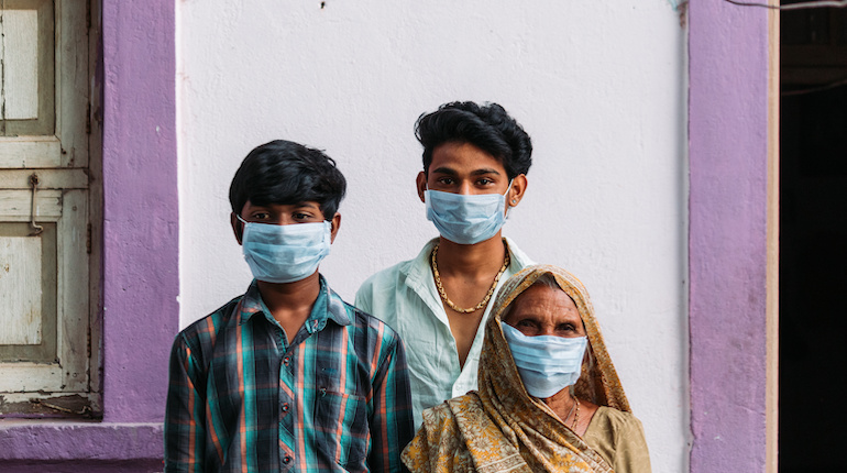 Indian family wearing surgical masks to protect themselves from the Corona Virus Pandemic