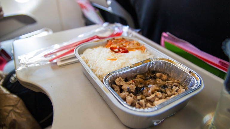 Asian meal kept on a flight's tray table