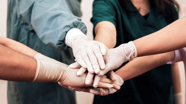 Group of Surgeon medical team coordinate handshaking.Team of doctors and nurses work together to fight against diseases and viruses.