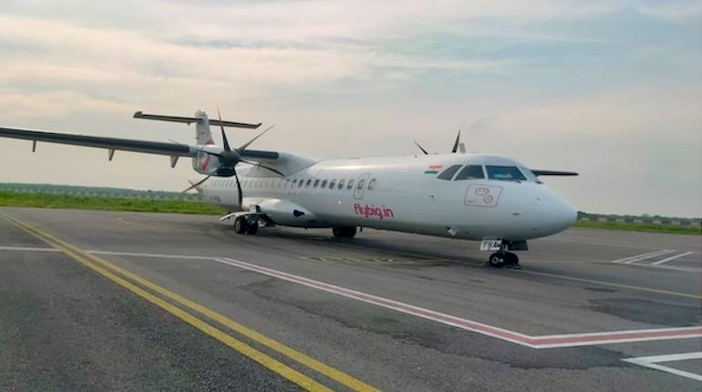 Flybig flight at Rupsi Airport on runway