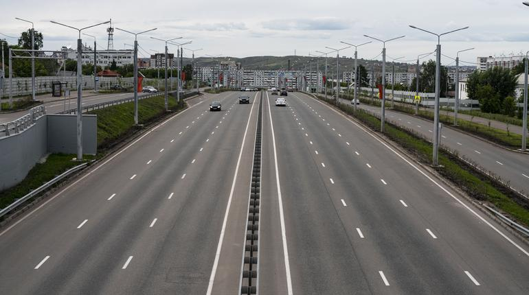 Deserted multi-lane road in the city. Road with a dividing strip.