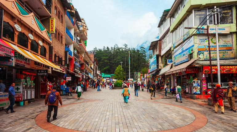 MANALI, INDIA - SEPTEMBER 27, 2019: The Mall is a main pedestrian street in Manali town, Himachal Pradesh state of India