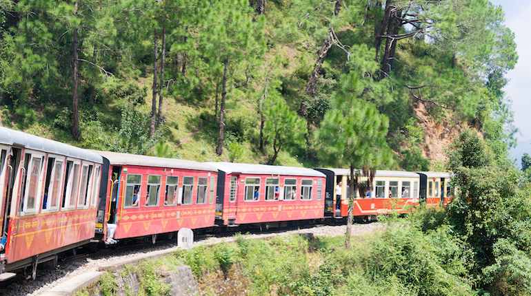 kalka shimla train passing through hilly forest in north india