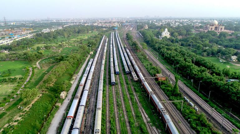 Indian passenger trains at a rail yard