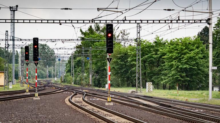 Red semaphores and railway tracks. Traffic lights shows red signal on railway.