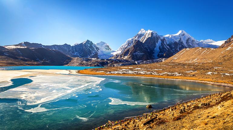 Himalayan Gurudongmar lake at North Sikkim India located at an altitude of 17840 feet.