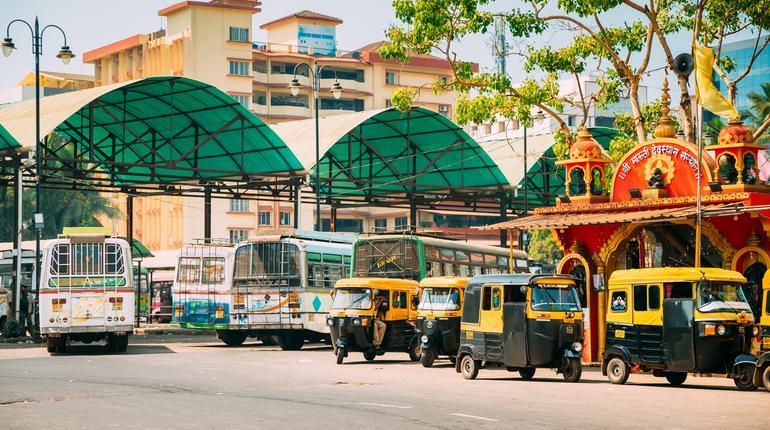 Panaji, Goa, India - February 19, 2020: Buses And Auto Rickshaw Or Tuk-tuk parked Near Bus Station. Panaji KTC Bus Stand